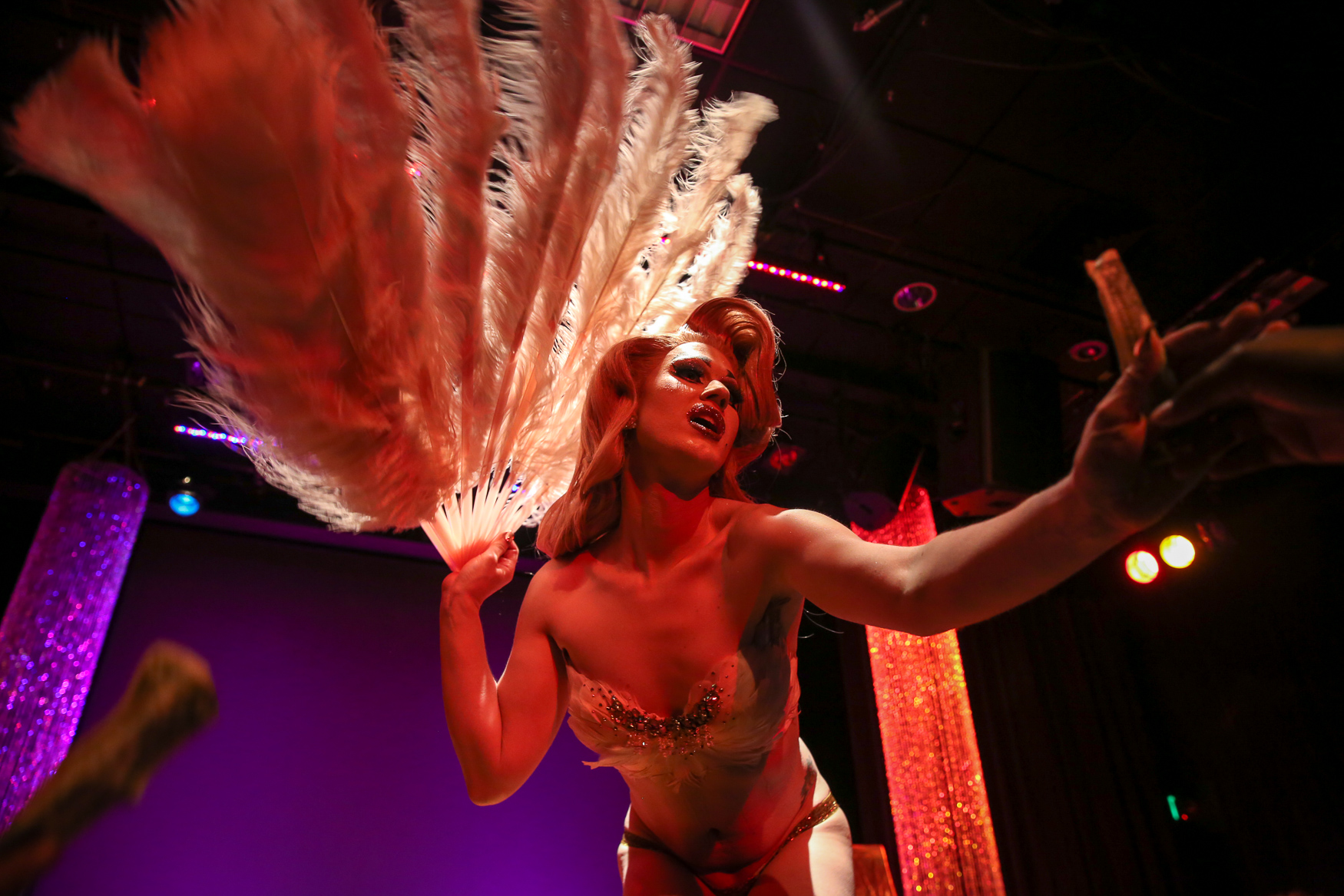 Betty-Oh-Hell-No takes her tips at the annual Baltimore Drag Awards in October.{ }(Amanda Andrade-Rhoades/DC Refined)
