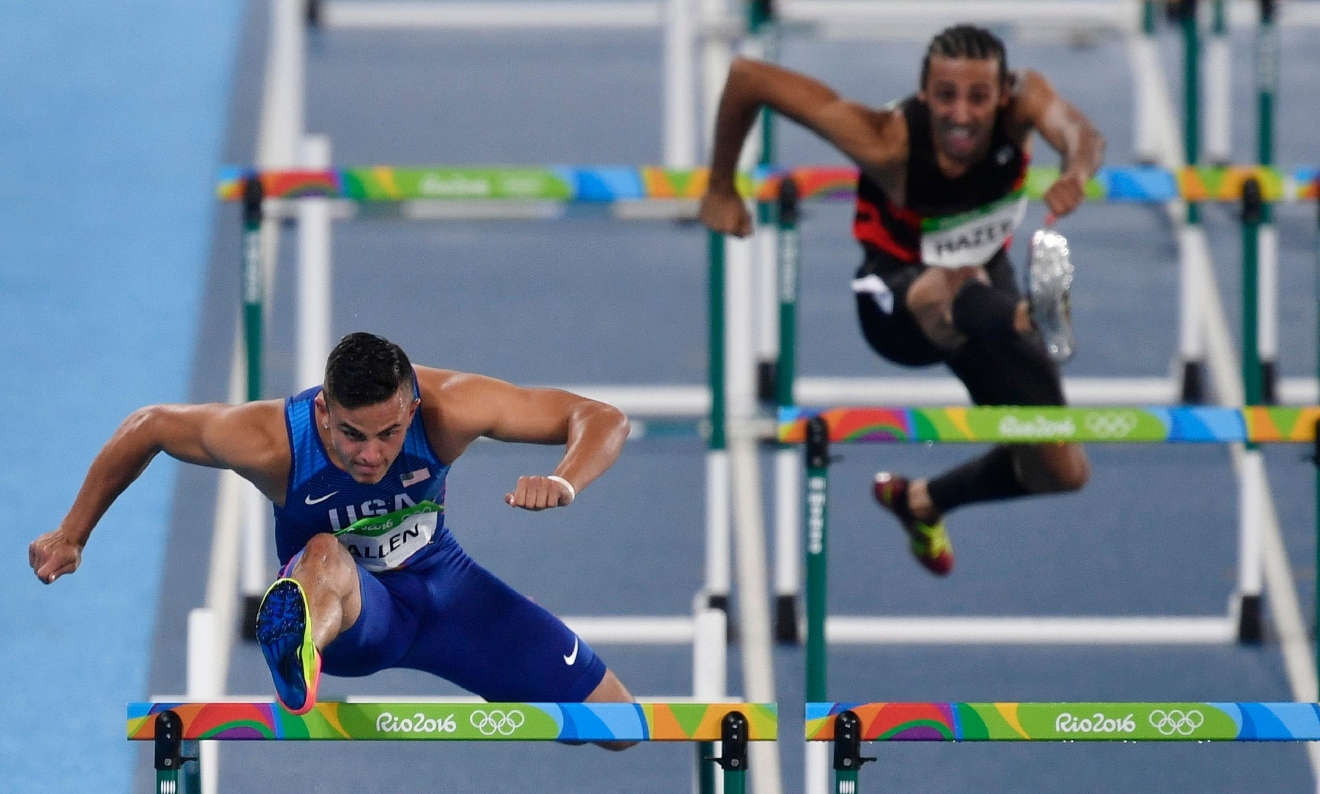 United States' Devon Allen, left, competes in a men's 110-meter hurdles heat during the athletics competitions of the 2016 Summer Olympics at the Olympic stadium in Rio de Janeiro, Brazil, Monday, Aug. 15, 2016. (AP Photo/Martin Meissner)
