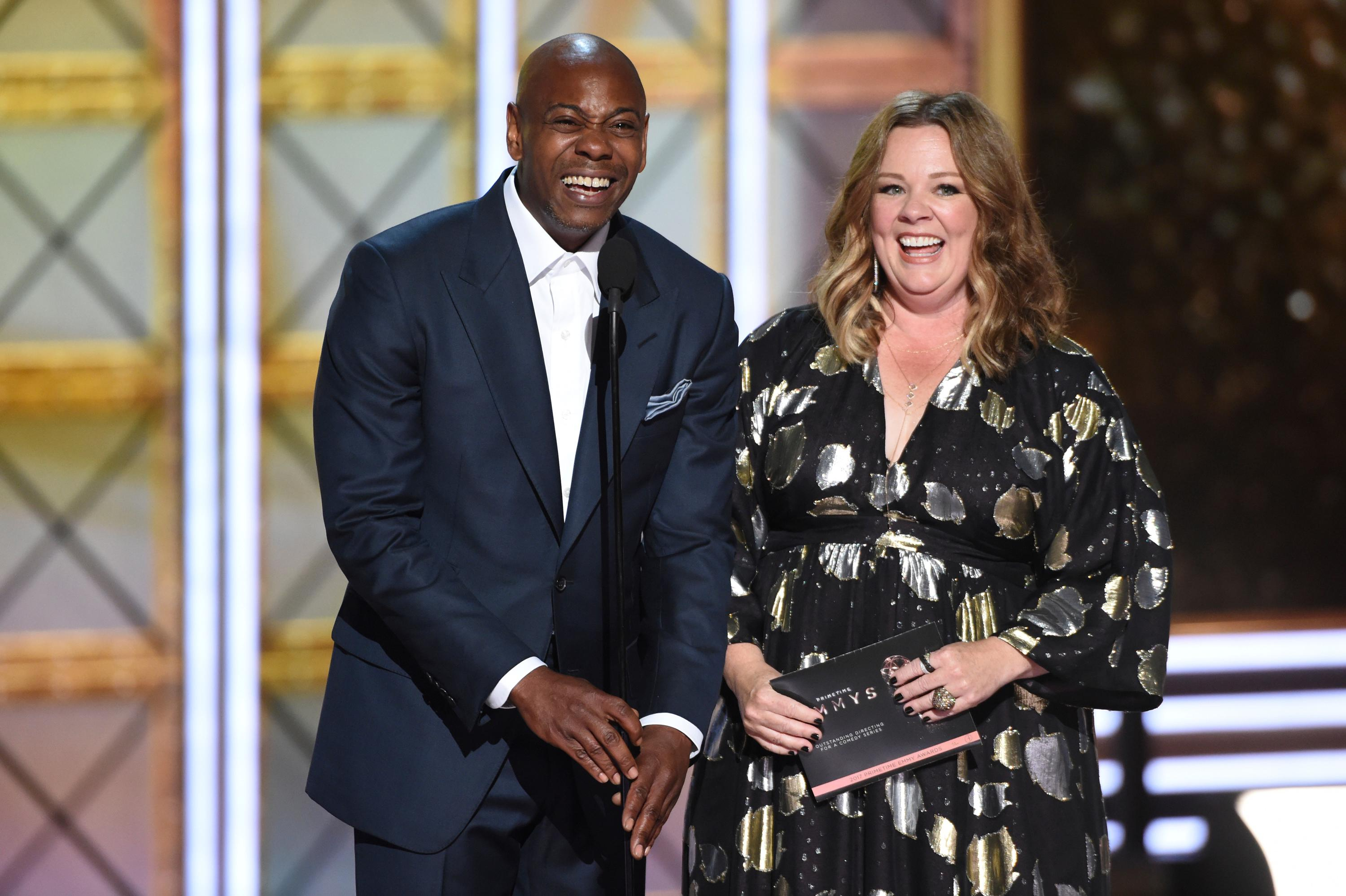 Dave Chappelle, left, and Melissa McCarthy present the award for outstanding directing for a comedy series at the 69th Primetime Emmy Awards on Sunday, Sept. 17, 2017, at the Microsoft Theater in Los Angeles. (Photo by Phil McCarten/Invision for the Television Academy/AP Images)